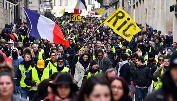 Protestors march as they take part in an anti-government demonstration called by the 'Yellow Vests'