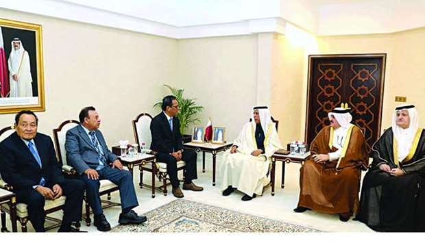 HE Ahmed bin Abdullah bin Zaid al-Mahmoud and other Council members during a meeting with Wesley Sim