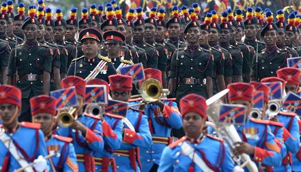 Sri Lankan military personnel march during the island's 71st Independence Day celebrations in Colomb