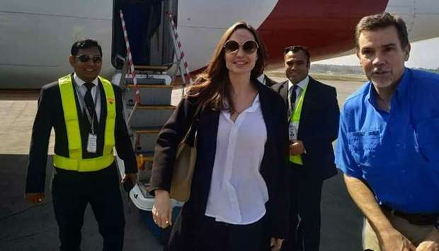 US actress and humanitarian Angelina Jolie arrives at the airport in Cox's Bazar