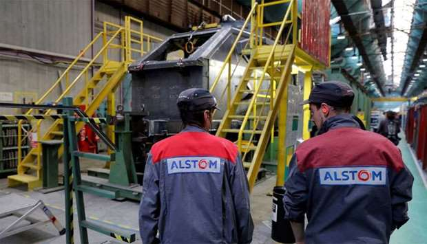 Employees work at the Alstom high-speed train TGV factory in Belfort, France