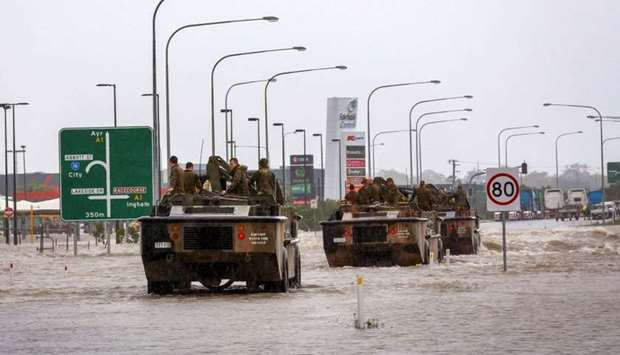 Army vehicles enter Townsville to help evacuate flood-affected people from Townsville