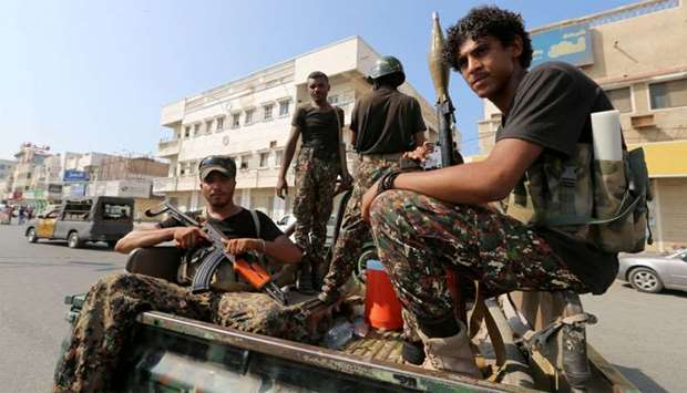 Houthi militants patrol a street where pro-Houthi demonstrated in Hodeidah