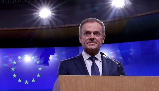 EU Council President Donald Tusk gives a statement at the European Council headquarters