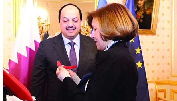 French Minister Florence Barley awards HE Dr Khalid bin Mohamed al-Attiyah the National Order of the