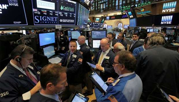 Traders work on the trading floor at the New York Stock Exchange