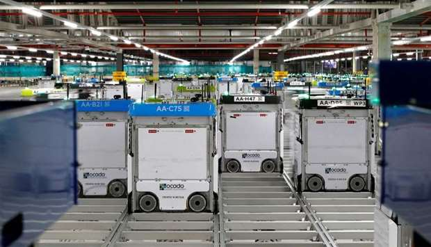 "Robots are seen on the grid of the ""smart platform"" at the Ocado warehouse at Andover"