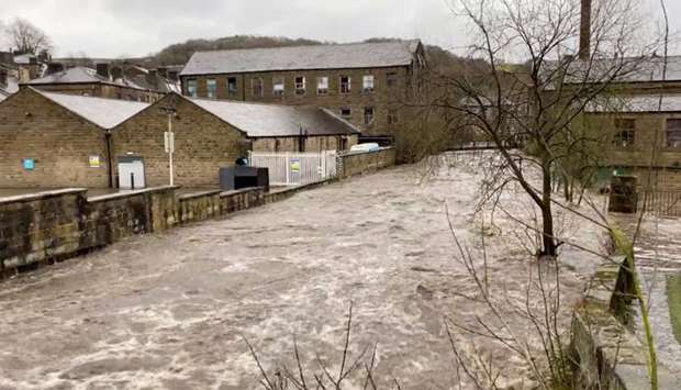 A flooded street is seen after Storm Ciara downpour in Hebden Bridge, West Yorkshire, Britain