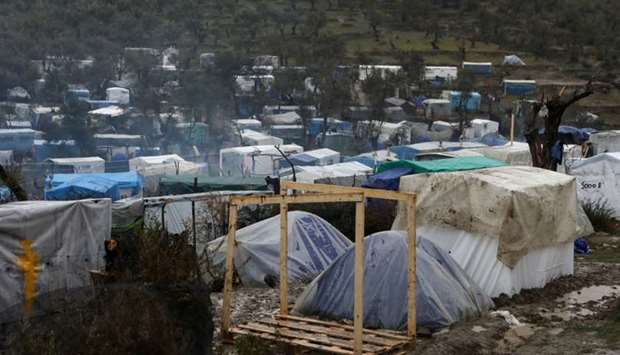 A view of temporary camp for refugees and migrants next to the Moria camp during heavy rainfall on t