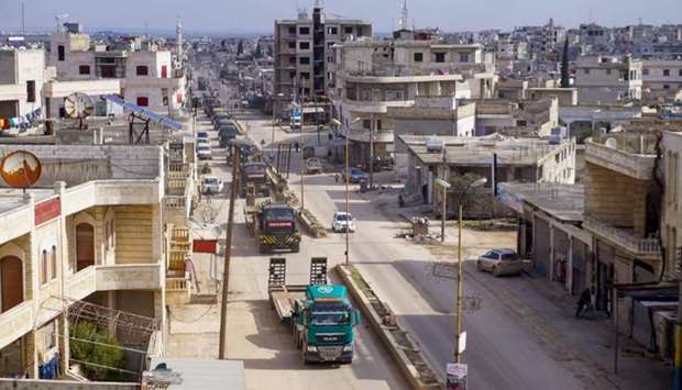 A Turkish military convoy passes through the town of Binnish in Syria's northwestern province of Idl