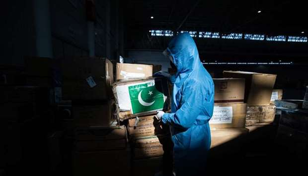 This photo taken on February 4, 2020 shows a staff member carrying a box of medical supplies from Pa