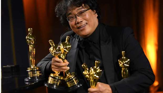 South Korean film director Bong Joon Ho poses with his engraved awards as he attends the 92nd Oscars