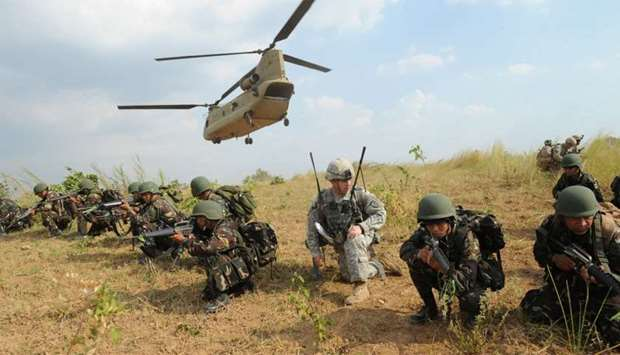 Philippine soldiers and a US Army soldier during an air assault exercise