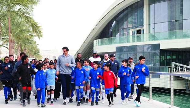 His Highness the Amir Sheikh Tamim bin Hamad al-Thani taking part in the activities of the Qatar Nat