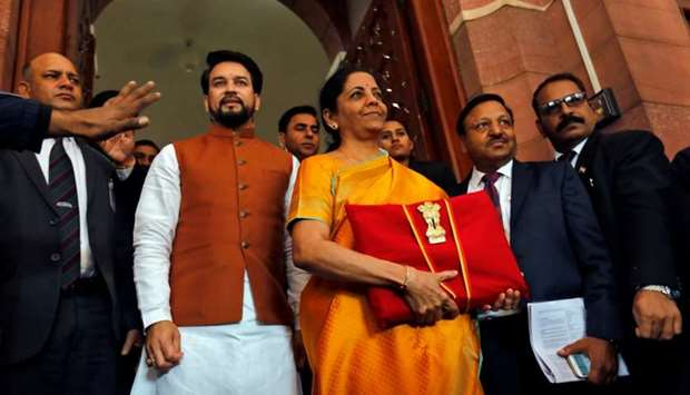 India's Finance Minister Nirmala Sitharaman is flanked by junior Finance Minister Anurag Thakur as s