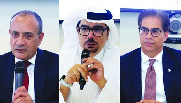 Commercial Bank Group CEO Joseph Abraham, Hussein Ali al-Abdulla, executive general manager and chie
