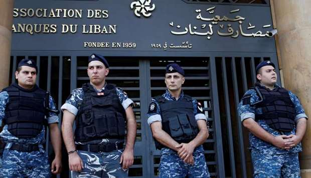 Lebanese police stand outside the entrance of the Association of Banks in downtown Beirut, Lebanon.