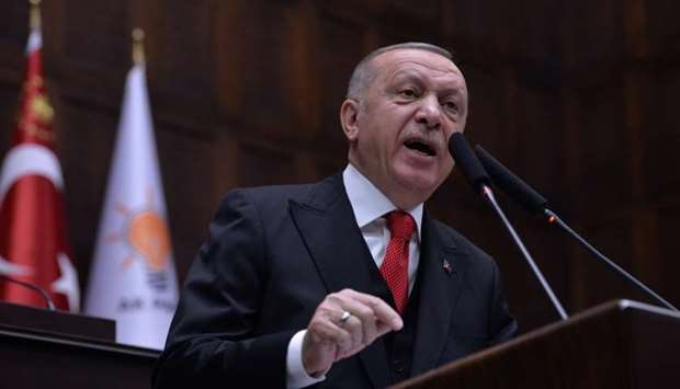 Turkish President Tayyip Erdogan addresses members of his ruling AK Party at the parliament in Ankar