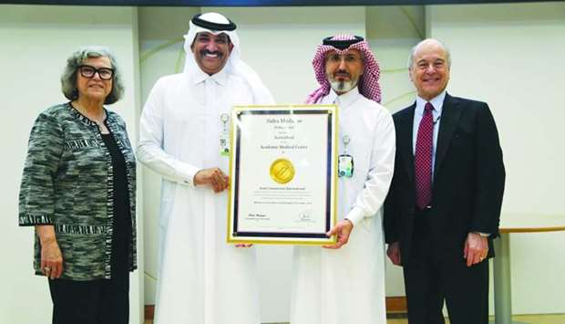 Dr Abdulla al-Kaabi and Mohamed K al-Mana receiving the official JCI certificate.