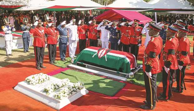 Members of the Kenya Defence Forces (KDF) salute the coffin of late former president Daniel Arap Moi