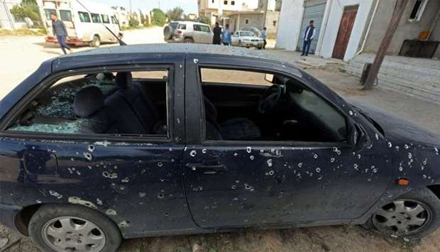 A car after a shell landed in a residential neighbourhood near Tripoli University in the Libyan capi
