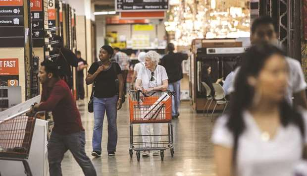 Customers shop at a Home Depot store in New York. Data for December was revised down to show the so-