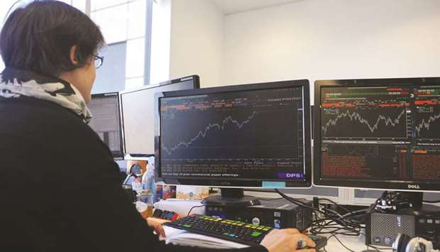 A trader works at the London Stock Exchange. The FTSE 100 underperformed its European peers with a 0