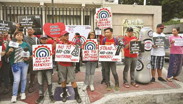 Supporters hold placards during a protest in support of local broadcast giant ABS-CBN in Manila, yes