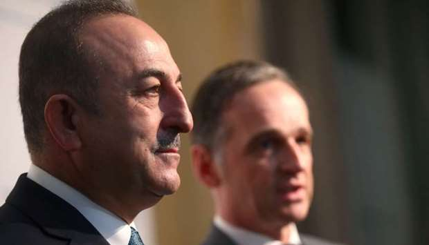 German Foreign Minister Heiko Maas and Turkish Foreign Minister Mevlut Cavusoglu talk to the media a