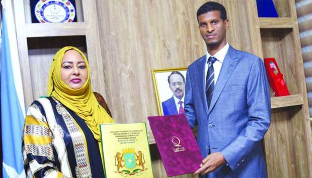 Somalia's Minister of Energy and Water Resources Fawzia Mohamed Sheikh, and Director of Qatar Charit