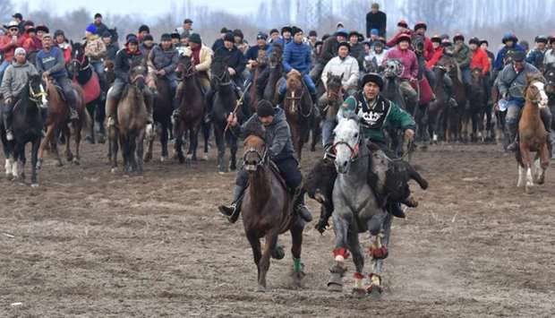 Kyrgyz riders compete during the horse game