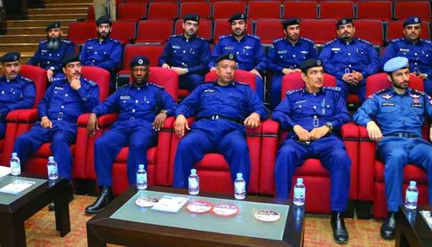 Major General Mohamed Saad al-Kharji, Director General of Traffic, and other officials at the press