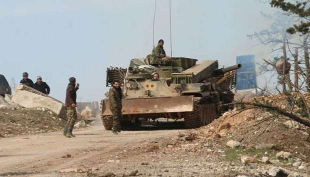 Syrian army soldiers are deployed in the town of Khan al-Assal, west of Aleppo