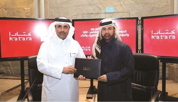 General Manager of Katara Dr Khaled bin Ibrahim al-Sulaiti and President of Kahramaa Engineer Essa b