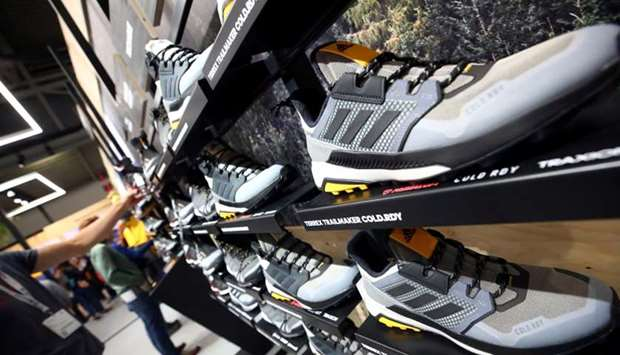 Trail running shoes are seen at the booth of Adidas during the ISPO trade fair for sports equipment