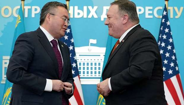 US Secretary of State Mike Pompeo buttons his jacket after holding a joint news conference with Kaza