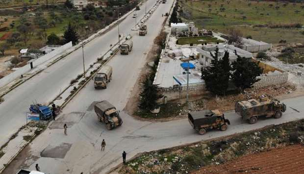An aerial view shows a Turkish military convoy that crossed into the Syrian territory via the Kafr L