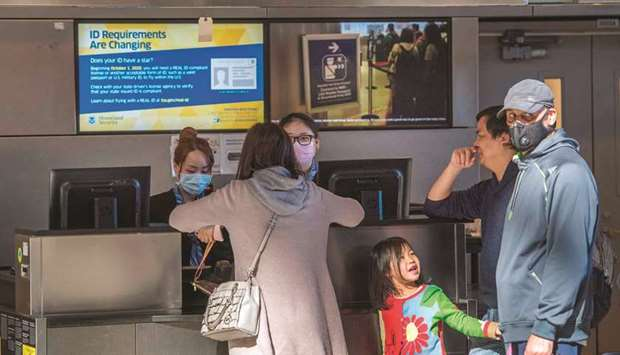 Standby passengers make inquiries at a check-in counter, after the departure of an Air China flight