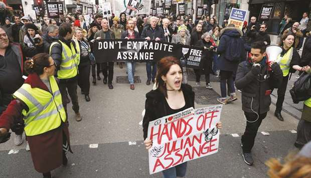 Demonstrators gather outside the Australian High Commission in London to protest against the extradi