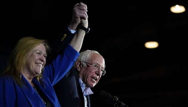 Democratic presidential candidate Sen. Bernie Sanders and his wife Jane Sanders take the stage after