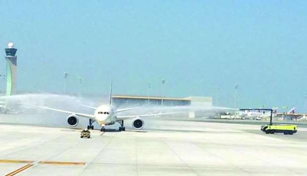 Air India's state-of-the-art Boeing 787 Dreamliner from Mumbai being given a water cannon salute at