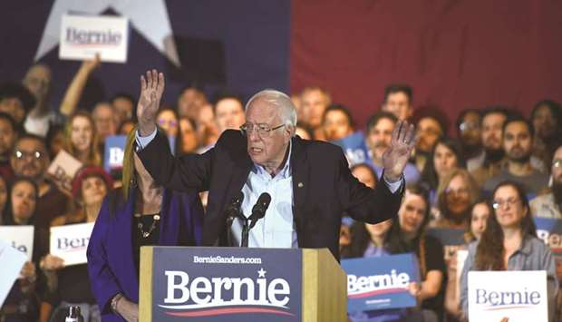 Democratic presidential candidate Senator Bernie Sanders celebrates after being declared the winner