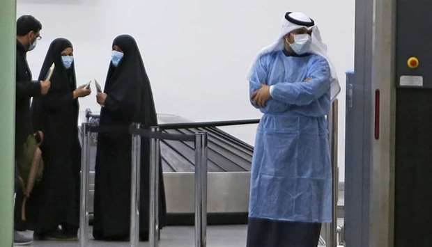 Kuwaitis coming back from Iran wait at Sheikh Saad Airport in Kuwait City