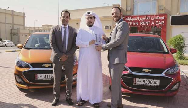 Jaidah Automotive and Ocean Rent a Car officials mark the occasion.