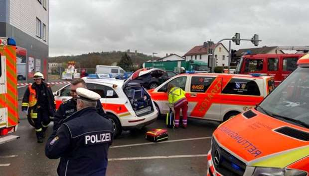 :Emergency vehicles at the scene after a car ploughed into a carnival parade injuring several people