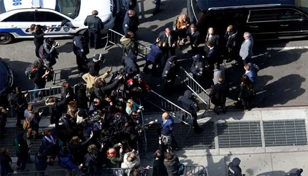 Police, lawyers and media assemble outside of New York County Criminal Court following film producer