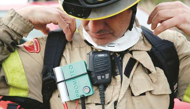 A Prometeo monitoring device (by IBM) is worn by a firefighter during prescribed burn of the forest