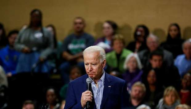 Democratic US presidential candidate and former US Vice President Joe Biden listens as an attendee a