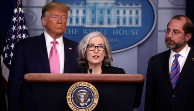 US President Donald Trump and Health and Human Services (HHS) Secretary Alex Azar listen as Dr. Anne