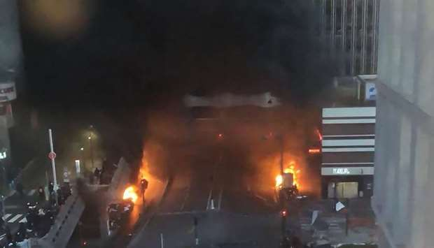 Vehicles and bins burning in a street aside the Gare de Lyon rail station in Paris yesterday